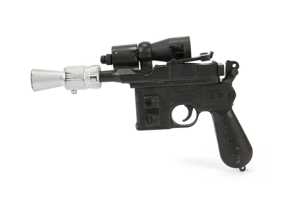 "A blaster used by Harrison Ford, who played Han Solo, in ""Return of the Jedi."" The original production used BlasTech DL-44 blaster prop weapon was custom-made specifically for the film. (Julien's ..."