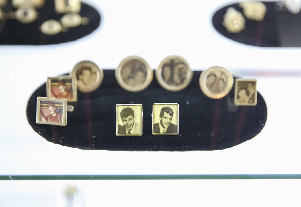 A group of cufflinks with photographs of comedian Jerry Lewis and others on display during the Julian's Auctions Property from the estate of Jerry Lewis inside Planet Hollywood Resort in Las Vegas ...