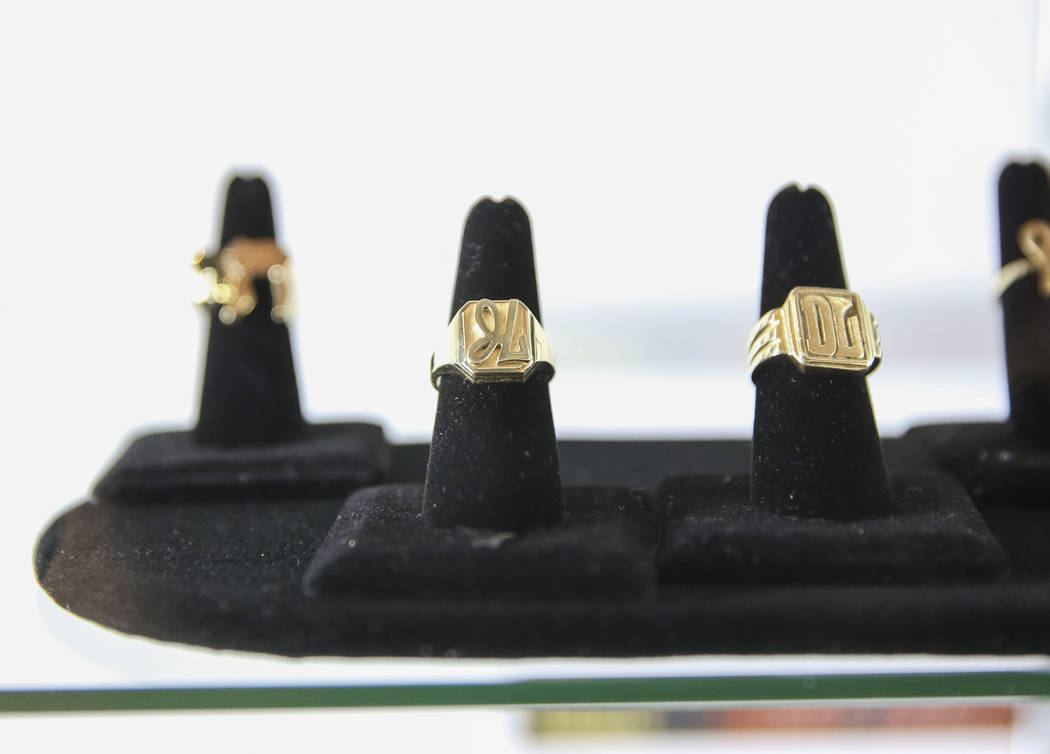 Gold rings belonging to late comedian Jerry Lewis on display during the Julian's Auctions Property from the estate of Jerry Lewis inside Planet Hollywood Resort in Las Vegas on Monday, June 18, 20 ...