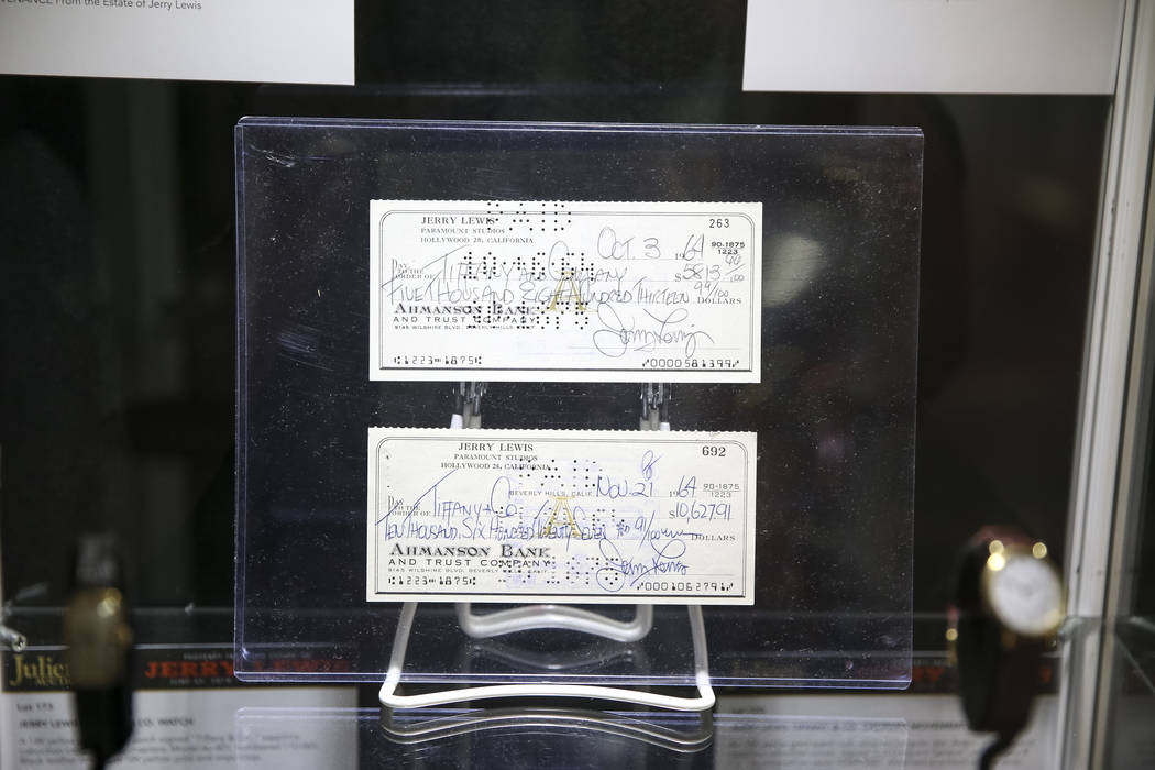 Checks signed by late comedian Jerry Lewis on display during the Julian's Auctions Property from the estate of Jerry Lewis inside Planet Hollywood Resort in Las Vegas on Monday, June 18, 2018. Ric ...