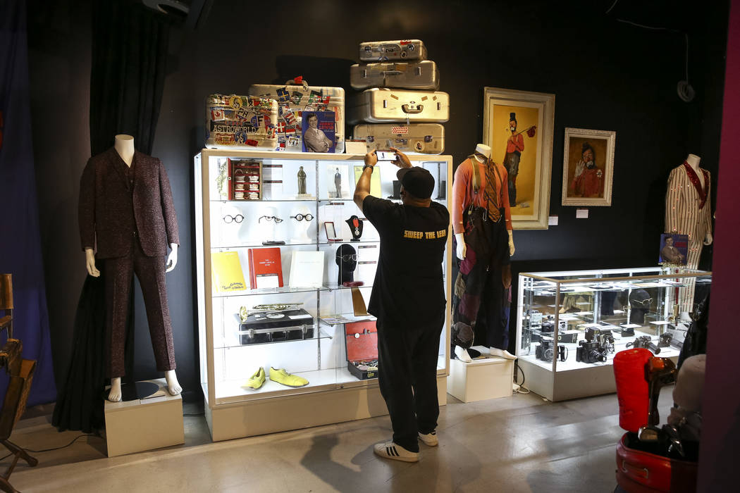 People browse items belonging to late comedian Jerry Lewis on display during the Julian's Auctions Property from the estate of Jerry Lewis inside Planet Hollywood Resort in Las Vegas on Monday, Ju ...