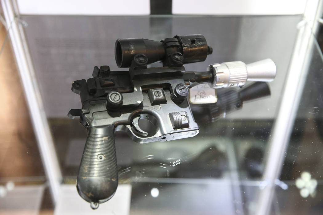 "An original production of the ""BlasTech DL-44"" blaster prop used by Harrison Ford as Han Solo in Return of the Jedi on display as part of Julian's Auctions Hollywood Legends collection a ..."