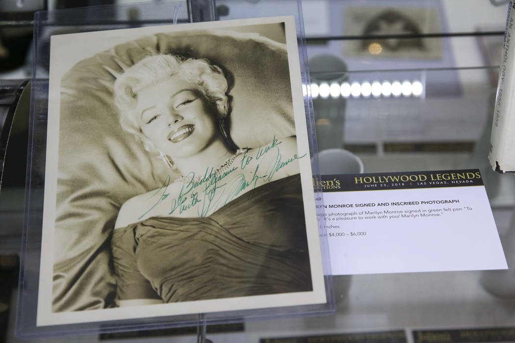 A photo signed by Marilyn Monroe on display as part of Julian's Auctions Hollywood Legends collection at Planet Hollywood in Las Vegas on Monday, June 18, 2018. Items from the Hollywood Legends co ...