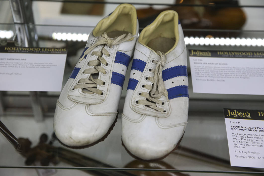 A pair of shoes once owned by actor Bruce Lee on display as part of Julian's Auctions Hollywood Legends collection at Planet Hollywood in Las Vegas on Monday, June 18, 2018. Items from the Hollywo ...
