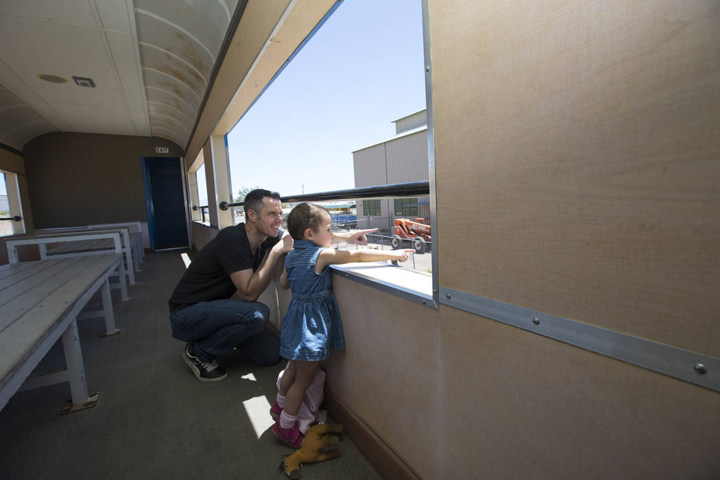 Stephen Hill and his 23-month-old daughter, Ivie, of Colorado take a father's day ride on the Southern Nevada Railroad Museum train in Boulder City on Sunday, June 17, 2018. Richard Brian Las Vega ...