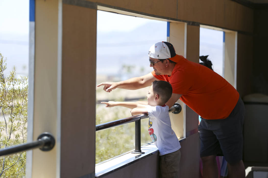 Las Vegas residents Sam Colarusso and his four-year-old son, Dominic, take a father's day ride on the Southern Nevada Railroad Museum train in Boulder City on Sunday, June 17, 2018. Richard Brian ...