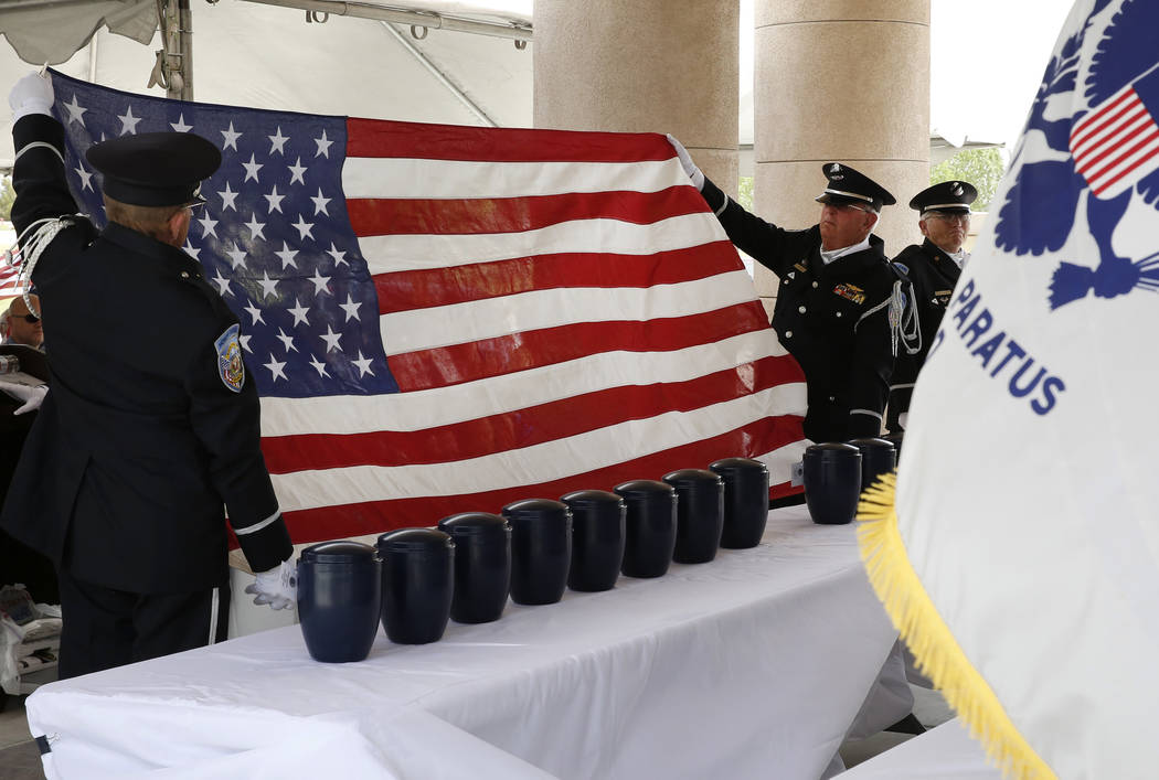 Members of the Nevada Veterans Coalition honor guard prepare to fold an American Flag for presentation as 35 unclaimed veterans receive a military funeral service at the Southern Nevada Veterans M ...