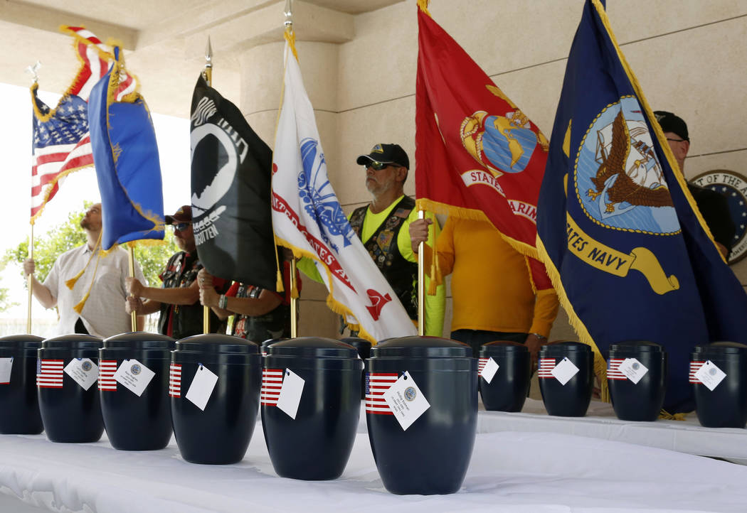 The remains of 35 unclaimed veterans are displayed during a military funeral service at the Southern Nevada Veterans Memorial Cemetery on Friday, June 15, 2018, in Boulder City. The Nevada Veteran ...