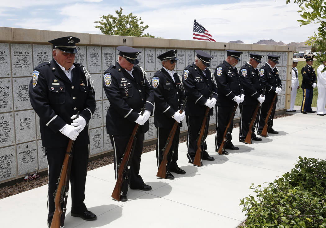 Members of the Nevada Veterans Coalition honor guard bow their heads in prayer as 35 unclaimed veterans receive a military funeral service at the Southern Nevada Veterans Memorial Cemetery on Frid ...