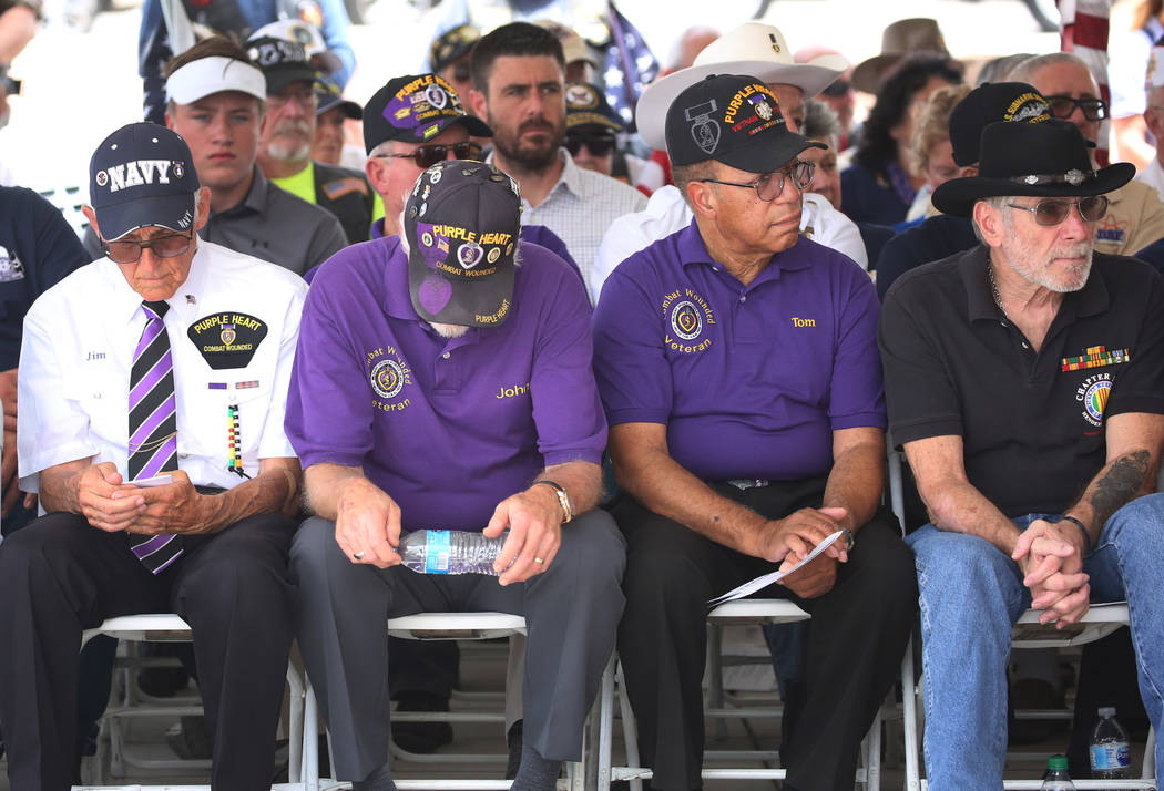 Combat wounded veterans attend a military funeral service at the Southern Nevada Veterans Memorial Cemetery on Friday, June 15, 2018, in Boulder City. The Nevada Veteran's Coalition conducted its ...