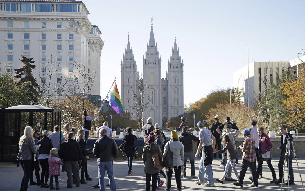 People walk past the Salt Lake Temple after mailing resignation letters during a mass resignation from the Church of Jesus Christ of Latter-day Saints in Salt Lake City in 2015. (AP Photo/Rick Bowmer)