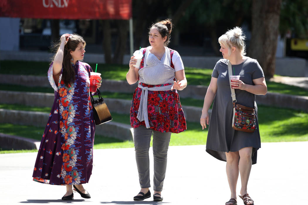 Alisha Kerlin, left, Lilia Todd, center, carrying her two-month-old son Harrison, and Meleah Smith, right, chat as they walk through the UNLV Student Union Courtyard on Friday, March 25, 2018, in ...