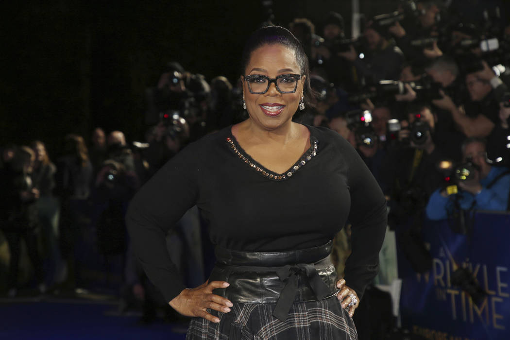 In this March 13, 2018, file photo, actress Oprah Winfrey poses for photographers upon arrival at the premiere of the film 'A Wrinkle In Time' in London. Apple said Friday, June 15, 2018, it has r ...