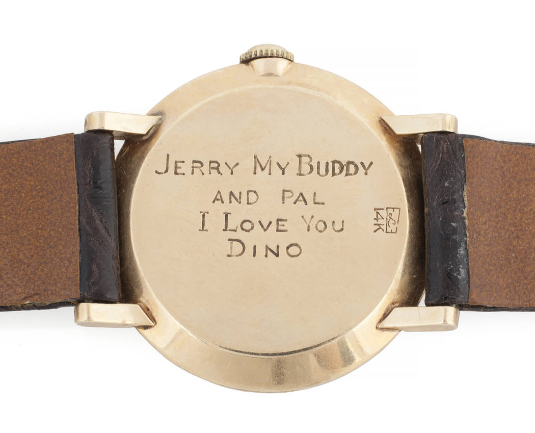 "Offered for sale at the Julien's Jerry Lewis & Hollywood Legends Auction on Friday at Planet Hollywood: A 14K yellow gold watch with satin finish and round dials on the gold bezel, signed ""Le Coul ..."
