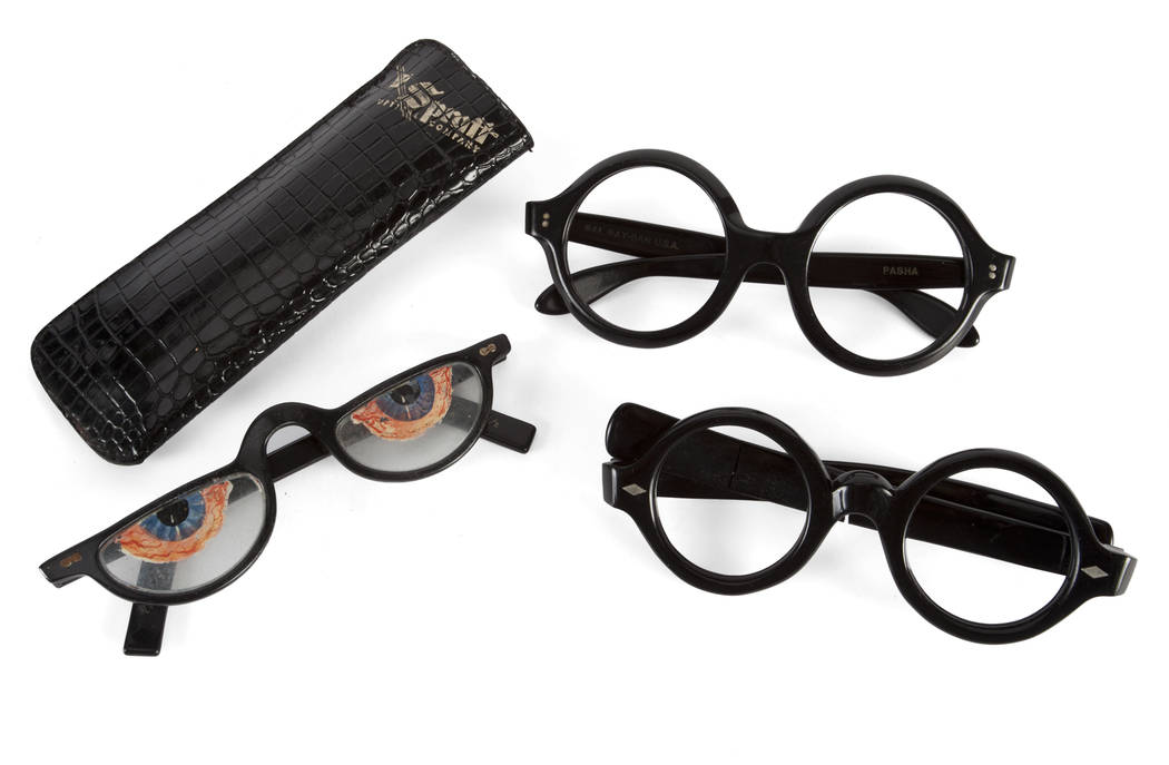 Offered for sale at the Julien's Jerry Lewis & Hollywood Legends Auction on Friday at Planet Hollywood: A trio of vintage prop black glasses frames. The first pair are large round frames with silv ...