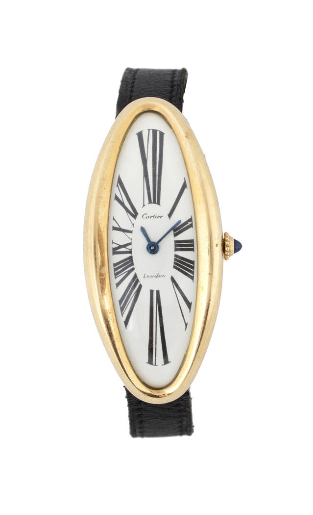 Offered for sale at the Julien's Jerry Lewis & Hollywood Legends Auction on Friday at Planet Hollywood: An 18K yellow gold watch signed Cartier, London, an oval maxi variation from their Baignoire ...