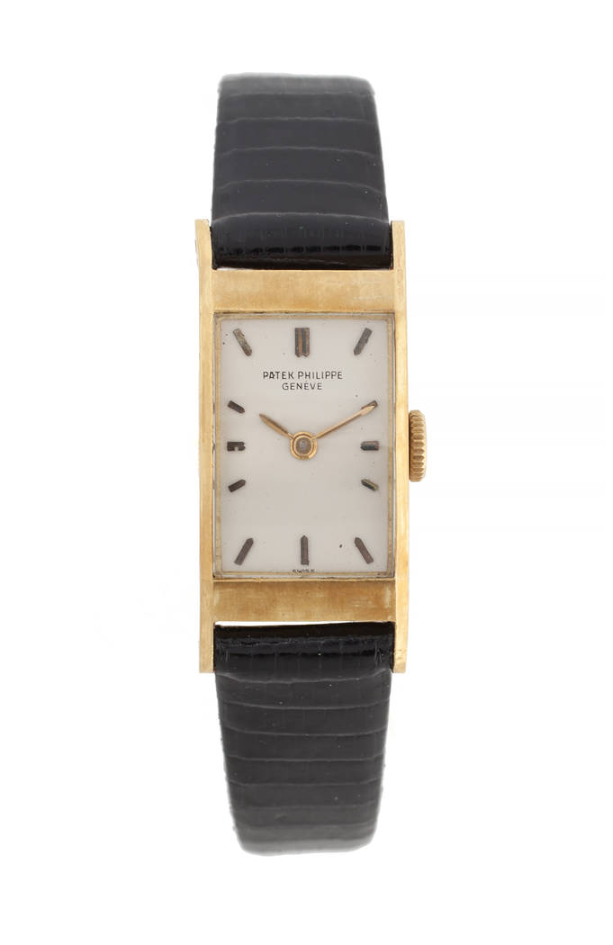 Offered for sale at the Julien's Jerry Lewis & Hollywood Legends Auction on Friday at Planet Hollywood: An 18-karat yellow gold watch with silvered baton chapters from Patek Philippe, Geneve, engr ...