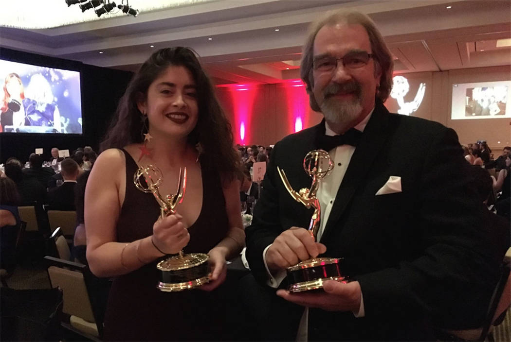 Rachel Aston and Michael Quine show off their trophies after winning regional Emmy Awards at the Pacific Southwest chapter of the National Academy of Television Arts and Sciences event on Saturday ...
