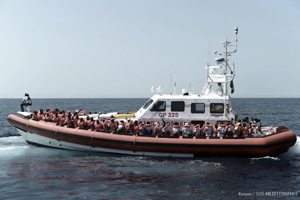 "FILE- This June 12, 2018 photo released Wednesday, June 13, 2018 by French NGO ""SOS Mediterranee"" shows migrants being transferred from the Aquarius ship to Italian Coast Guard boats, in ..."