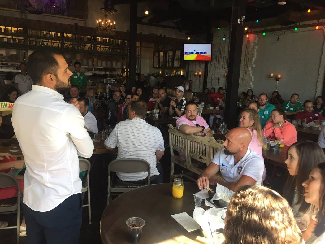 Lights FC coach Isidro Sanchez, left, watches Mexico's World Cup match with Germany with fans on Sunday at the Mexican restaurant La Comida. (Lights FC)