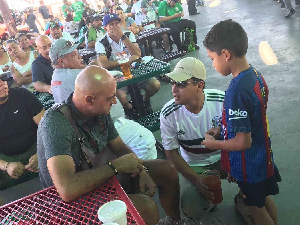 Lights FC technical director Jose Luis Sanchez Sola, left, talks with fans while watching Mexico's World Cup match against Germany at Broadacres Marketplace in Las Vegas on Sunday. (Lights FC)