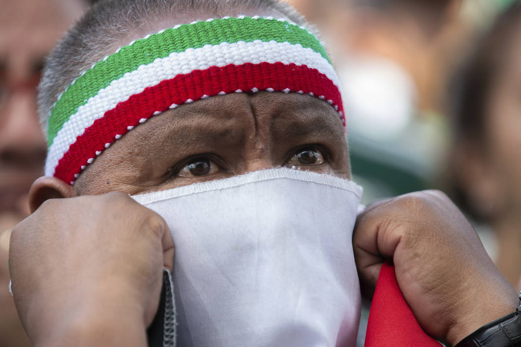 A Mexico fan covers his face as he watches the Mexico vs. Germany World Cup soccer match on an outdoor screen in Mexico City's Zocalo, Sunday, June 17, 2018. Mexico won it's first match against Ge ...