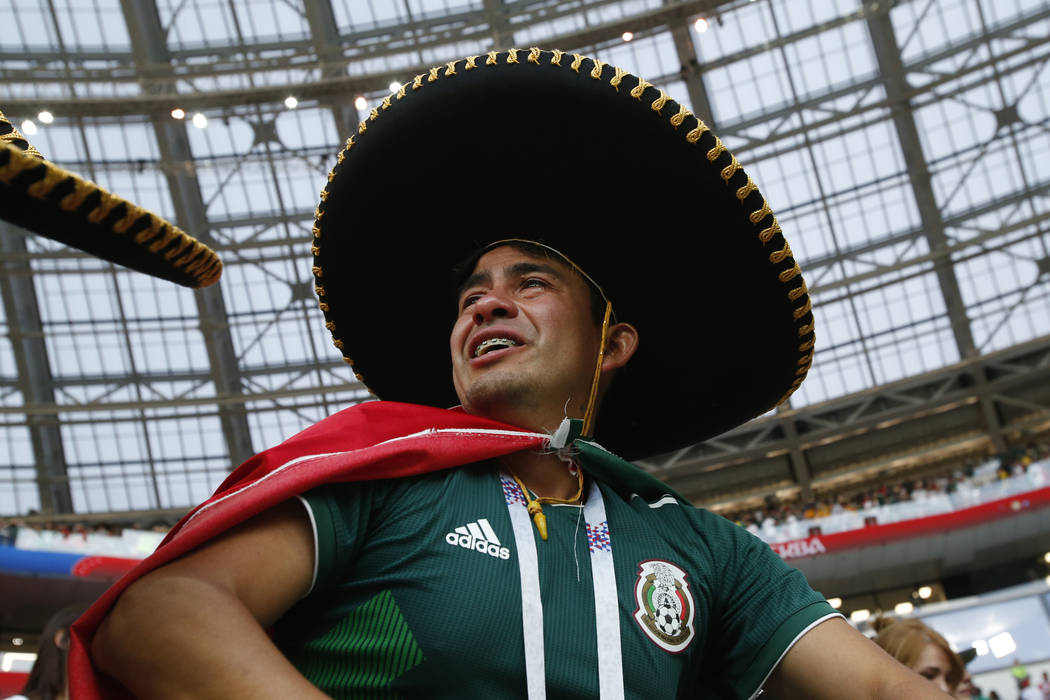 A Mexico fan cries as celebrates winning the group F match between Germany and Mexico at the 2018 soccer World Cup in the Luzhniki Stadium in Moscow, Russia, Sunday, June 17, 2018. Mexico won Germ ...
