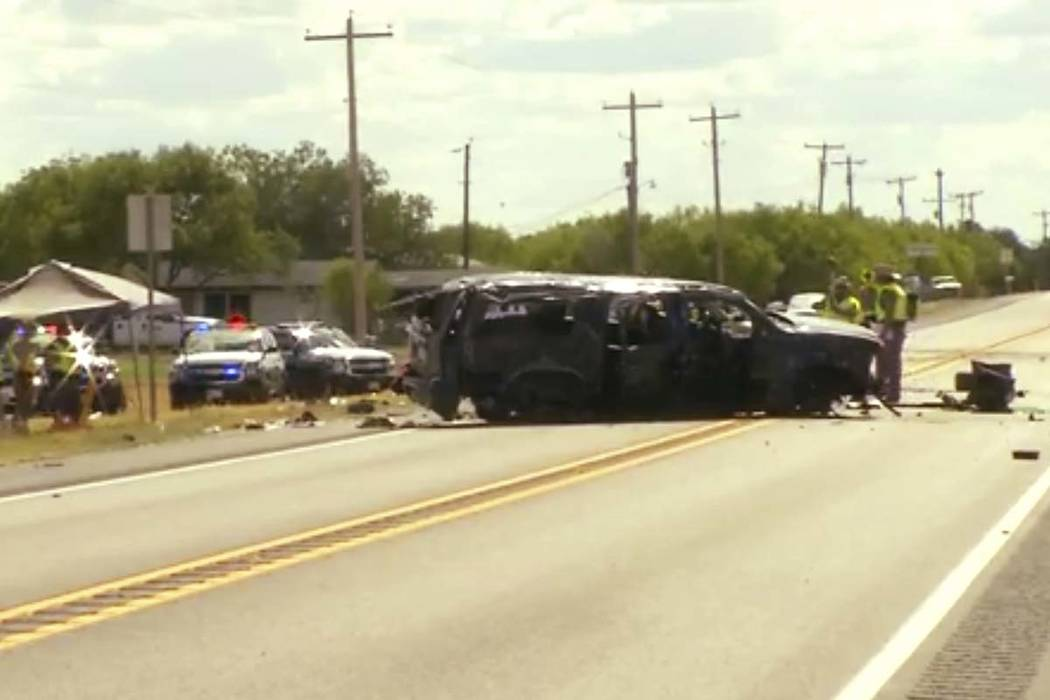 This frame grab from video provided by KABB/WOAI in San Antonio shows the scene where authorities say at least five people are dead and several others hurt as an SUV carrying more than a dozen peo ...