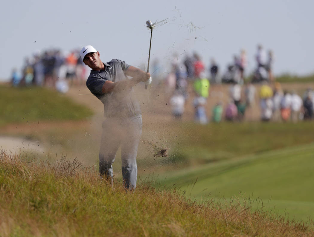 Brooks Koepka hits an approach shot on the 12th hole during the final round of the U.S. Open Golf Championship, Sunday, June 17, 2018, in Southampton, N.Y. (AP Photo/Frank Franklin II)