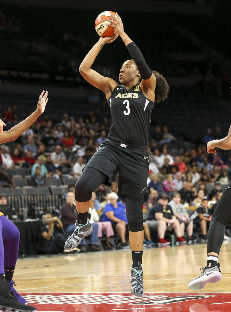 Las Vegas Aces center Kelsey Bone (3) takes a shot against the Phoenix Mercury during the first half of a WNBA basketball game at the Mandalay Bay Events Center in Las Vegas on Sunday, June 17, 20 ...