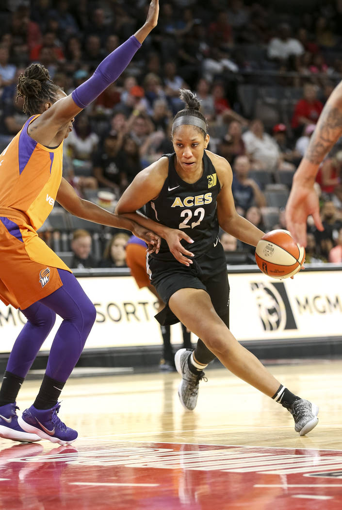 Las Vegas Aces center A'ja Wilson (22) drives the ball against Phoenix Mercury forward Sancho Lyttle (31) during the second half of a WNBA basketball game at the Mandalay Bay Events Center in Las ...