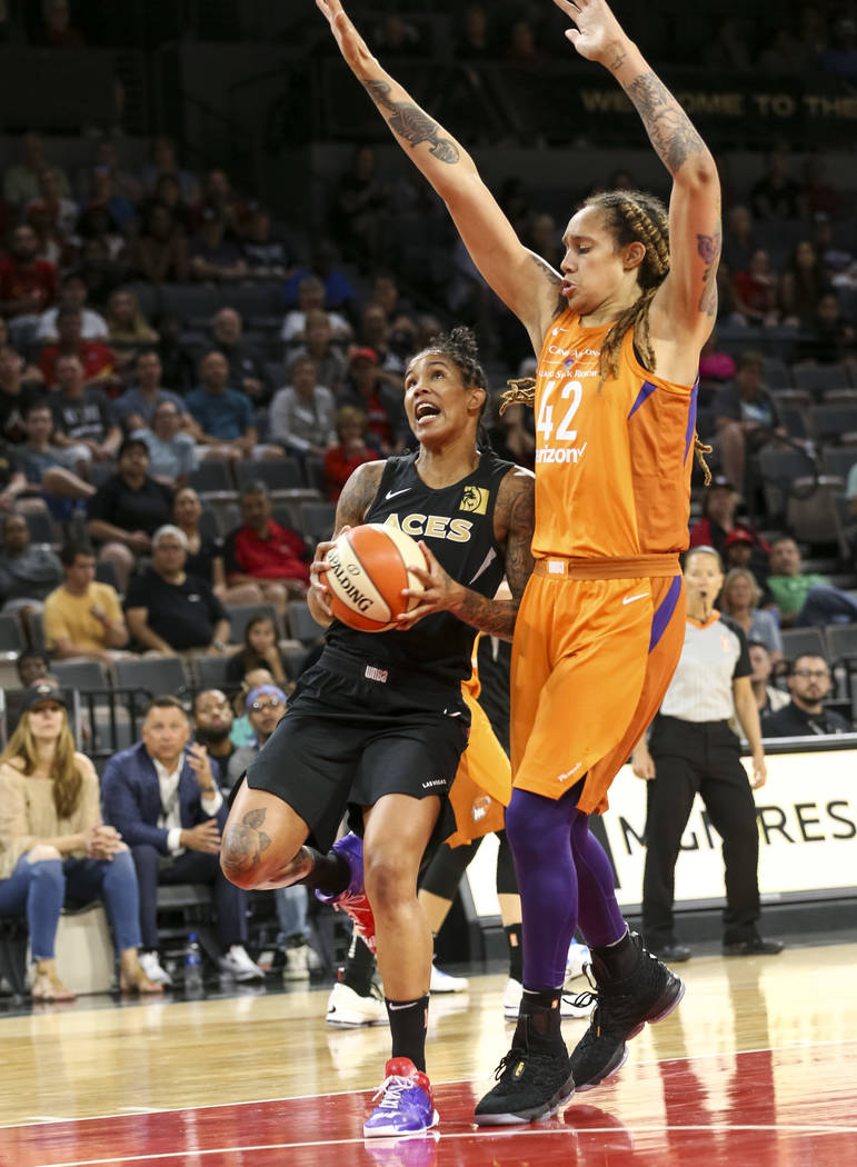 Las Vegas Aces forward Tamera Young (1) looks for a shot against Phoenix Mercury center Brittney Griner (42) during the second half of a WNBA basketball game at the Mandalay Bay Events Center in L ...