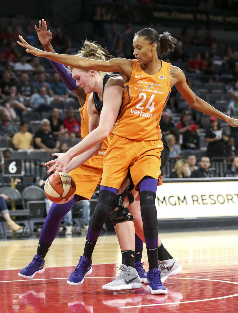 Phoenix Mercury forward DeWanna Bonner (24) defends in front of Las Vegas Aces center Carolyn Swords (8) during the second half of a WNBA basketball game at the Mandalay Bay Events Center in Las V ...