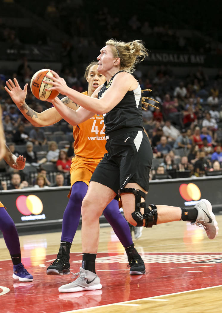 Las Vegas Aces center Carolyn Swords (8) drives to the hoop in front of Phoenix Mercury center Brittney Griner (42) during the second half of a WNBA basketball game at the Mandalay Bay Events Cent ...