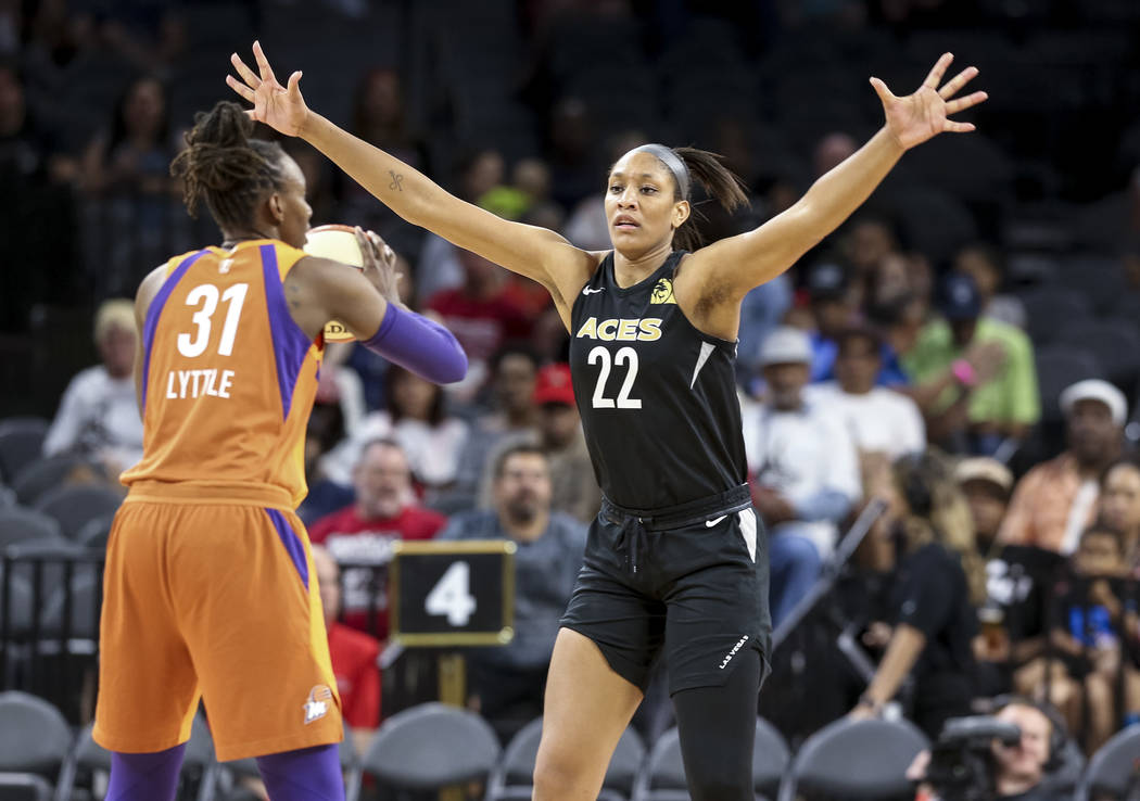 Phoenix Mercury forward Sancho Lyttle (31) looks to pass as Las Vegas Aces center A'ja Wilson (22) defends during the second half of a WNBA basketball game at the Mandalay Bay Events Center in Las ...
