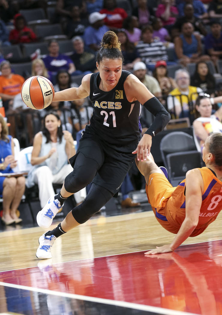 Las Vegas Aces guard Kayla McBride (21) drives the ball around Phoenix Mercury forward Stephanie Talbot (8) during the second half of a WNBA basketball game at the Mandalay Bay Events Center in La ...
