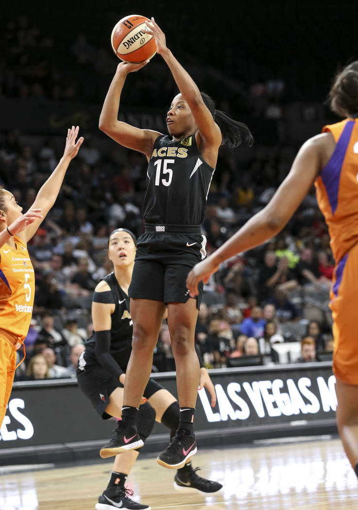 Las Vegas Aces guard Lindsay Allen (15) shoots over Phoenix Mercury guard Leilani Mitchell (5) during the second half of a WNBA basketball game at the Mandalay Bay Events Center in Las Vegas on Su ...