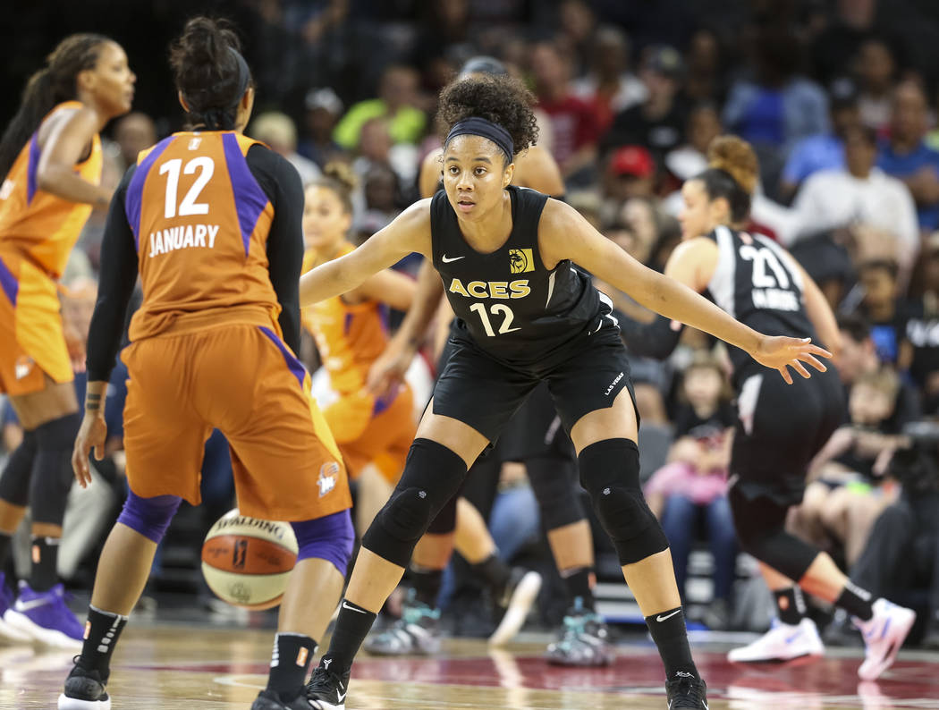 Las Vegas Aces forward Nia Coffey (12) defends against Phoenix Mercury guard Briann January (12) during the second half of a WNBA basketball game at the Mandalay Bay Events Center in Las Vegas on ...