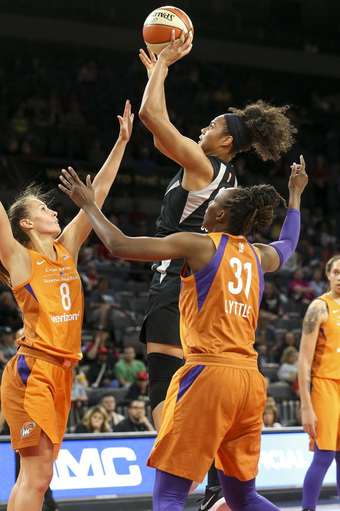 Las Vegas Aces forward Nia Coffey, center, shoots over Phoenix Mercury forwards Stephanie Talbot (8) and Sancho Lyttle (31) during the second half of a WNBA basketball game at the Mandalay Bay Eve ...