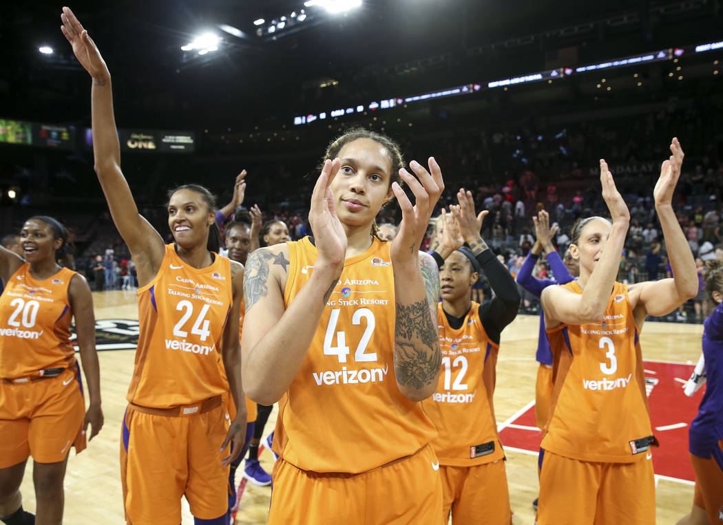 Members of the Phoenix Mercury, including center Brittney Griner (42), celebrate their 92-80 victory over the Las Vegas Aces following a WNBA basketball game at the Mandalay Bay Events Center in L ...