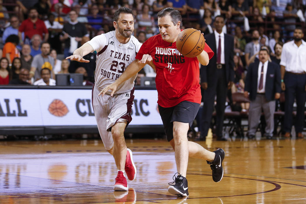 Senator Ted Cruz dribbles past Jimmy Kimmel during the Blobfish Basketball Classic and one-on-one interview at Texas Southern University's Health & Physical Education Arena Saturday, June 16, ...