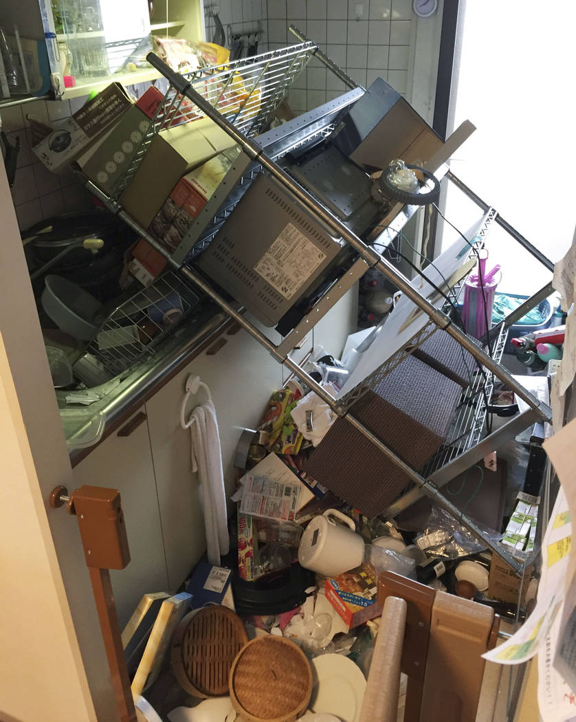 Scattered objects lie in the kitchen of a damaged house in Osaka, following an earthquake Monday, June 18, 2018. A strong earthquake has shaken the city of Osaka in western Japan. There are repor ...