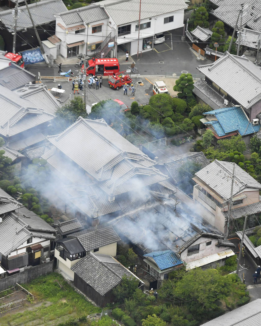 Smoke rises from a house blaze in Takatsuki, Osaka, following an earthquake Monday, June 18, 2018. A strong earthquake has shaken the city of Osaka in western Japan. There are reports of scattere ...