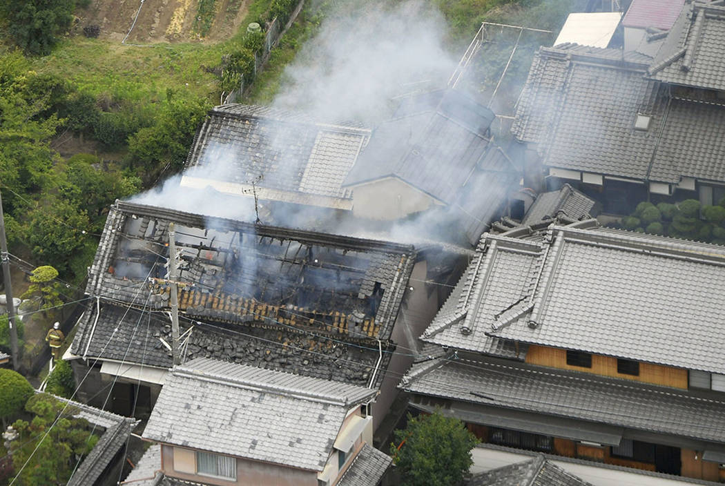 Smoke rises from a house blaze in Takatsuki, Osaka, following an earthquake Monday, June 18, 2018. A strong earthquake shook the city of Osaka in western Japan on Monday morning, causing scattere ...