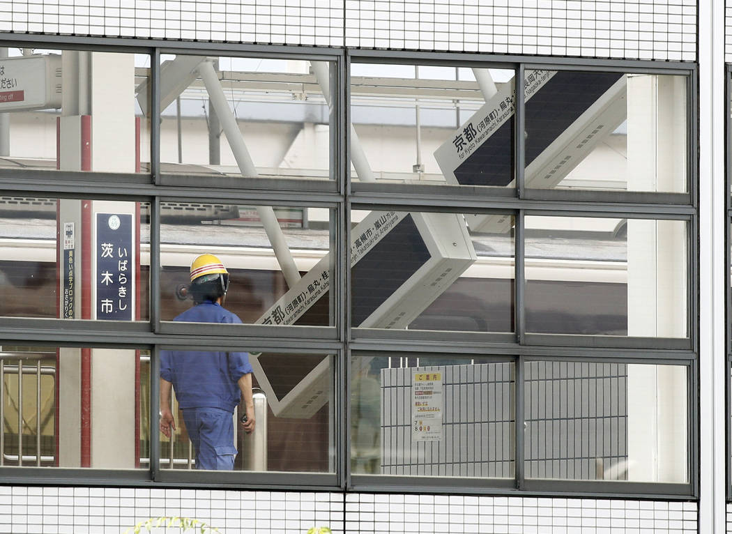 Electric boards lean at a platform of Ibaraki-shi train station in Ibaraki City, Osaka, western Japan, Monday, June 18, 2018. A strong earthquake knocked over walls and set off scattered fires aro ...