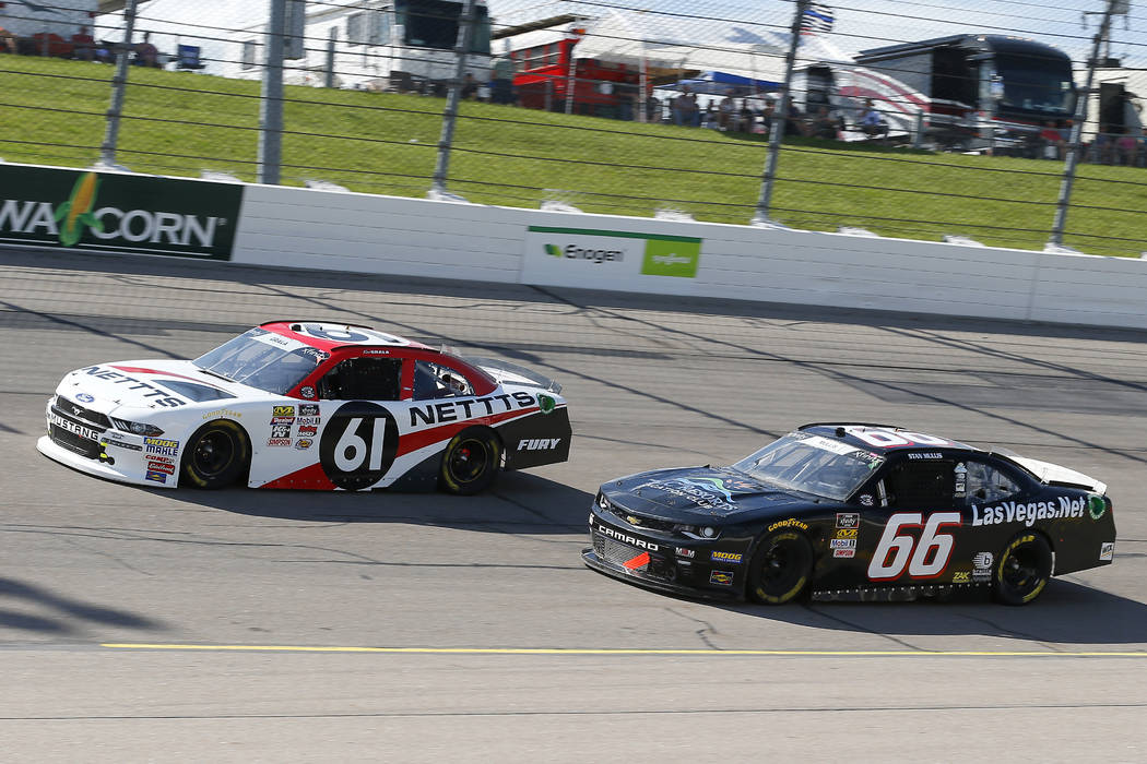Kaz Grala (61) and Stan Mullis (66) during the NASCAR Xfinity Iowa 250 race at Iowa Speedway, Sunday, June 17, 2018, in Newton, Iowa. (Russell LaBounty/NKP via AP) MANDATORY CREDIT