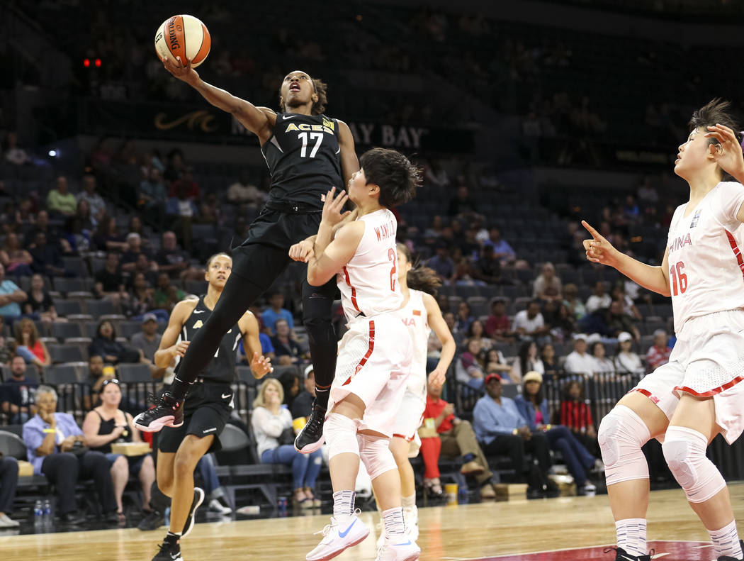 Las Vegas Aces guard/forward Sequoia Holmes (17) goes up for a shot against China's Jiaqi Wang during a preseason basketball game at Mandalay Bay Events Center in Las Vegas on Sunday, May 6, 2018. ...