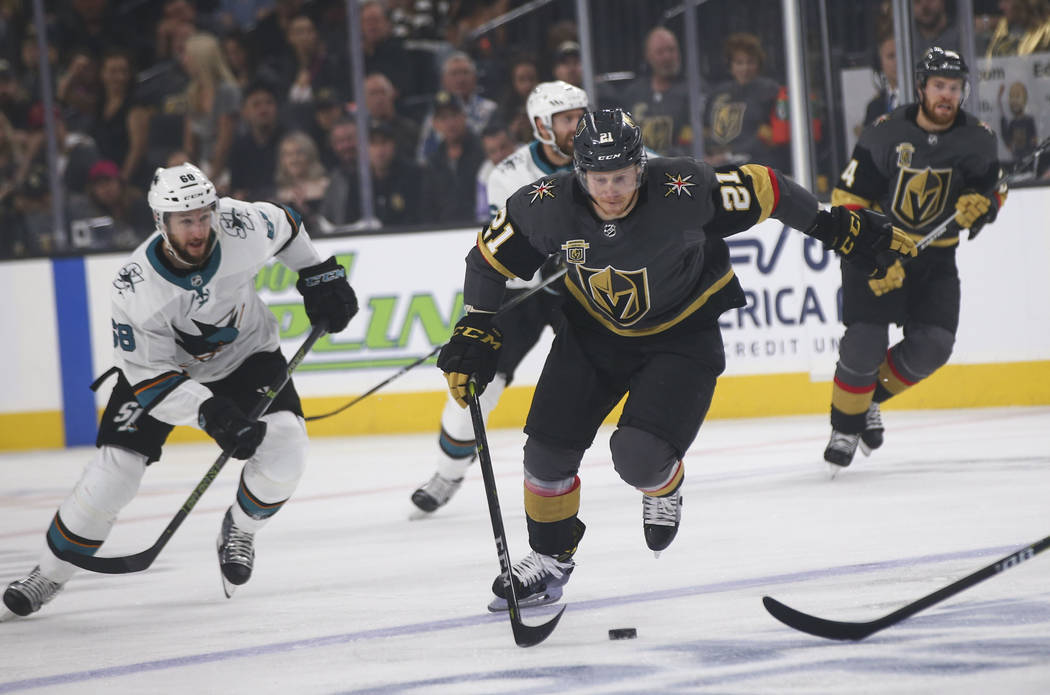 Golden Knights center Cody Eakin (21) moves the puck against the San Jose Sharks during the first period of Game 5 of an NHL hockey second-round playoff series at T-Mobile Arena in Las Vegas on Fr ...