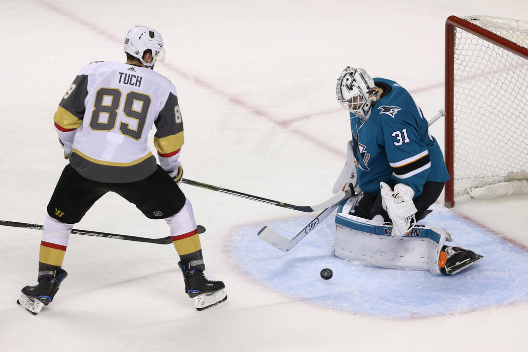 San Jose Sharks goaltender Martin Jones (31) defends a shot by Vegas Golden Knights right wing Alex Tuch (89) during the third period in Game 6 of an NHL hockey second-round playoff series at the ...