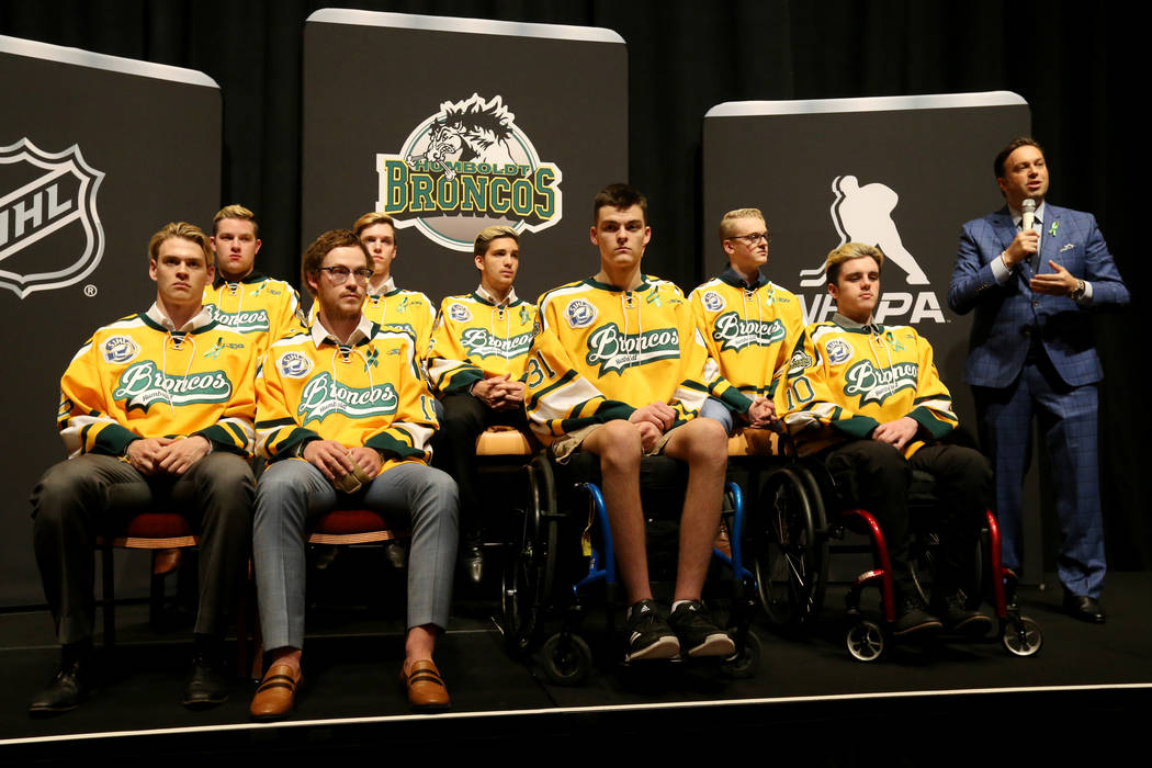 Elliotte Friedman from SportsNet, right, introduces the Humboldt Broncos at the Encore at Wynn Las Vegas Tuesday, June 19, 2018. The Broncos are, from left, Matthieu Gomercic, Derek Patter, Tyler ...